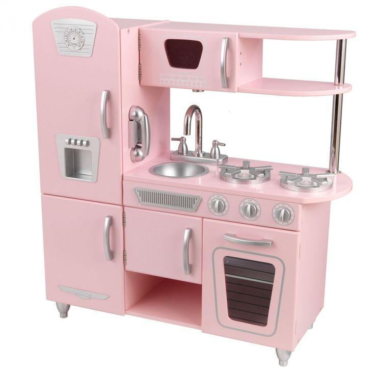 Cette ravissante cuisine pour enfantest en bois rose. Elle est très équipée et offre de multiples détails amusants pour votre petit chef cuisinier : -les portesdes armoiress'ouvrent et se ferment, - les boutons du four cliquent et tournent, - un téléphone sans fil, - un four à micro onde qui tourne (grâce à un bouton sous le meuble), - un évier amovible pour un nettoyage facile, les boutons desrobinets tournent eux aussi,  - un réfrigérateur américain avec distributeur de glaces, - un…