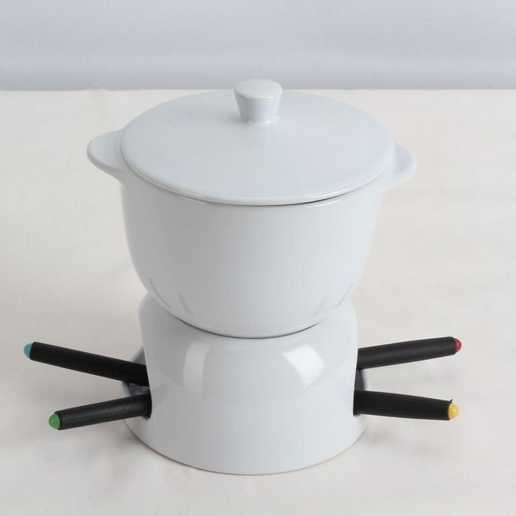 Features:  -Easy to clean.  -Includes a lid, a 24 oz bowl, a base for tealight candles and 4 forks.  -Microwave and dishwasher safe.  Type: -Fondue Sets.  Material: -Ceramic.  Capacity: -Less Than 2 Q