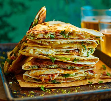 A seriously gourmet quesadilla. This easy, chicken-filled snack will curb your cheese cravings - serve warm and golden brown with your favourite dipping sauce