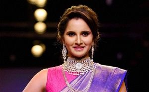 World No. 1 Tennis doubles player Sania Mirza on Friday expressed her happiness at being awarded with the Rajiv Gandhi Khel Ratna and dedicated the honour to her family and to India.