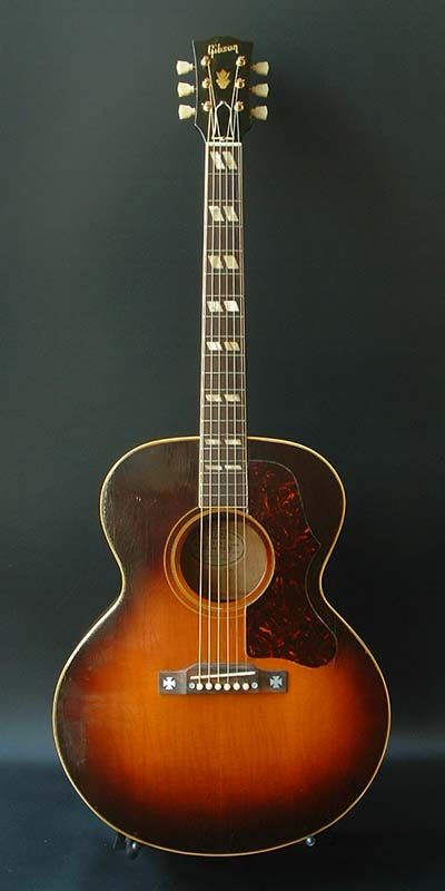 Gibson J-185 (1954) : Spruce top, Maple back & sides. Early spec. ( 19 frets. Scalloped bracing.  White label. )