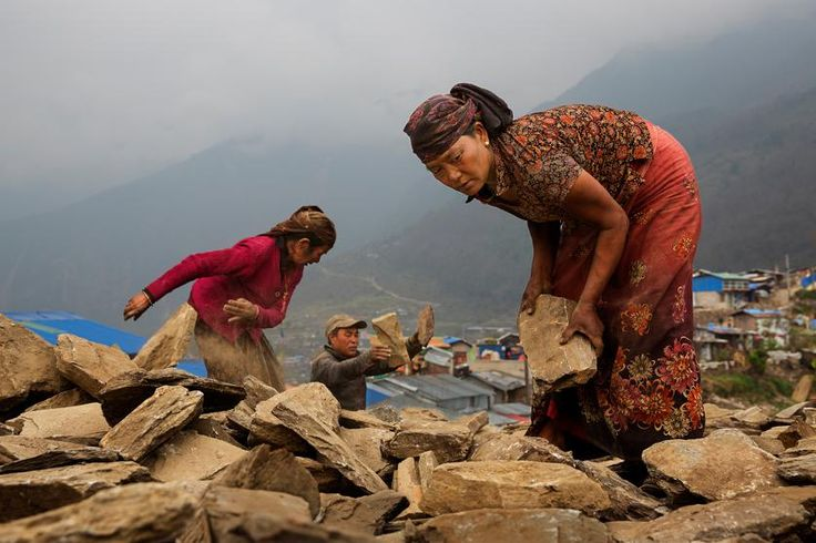 Nearly a year after Nepal's earthquakes of 2015, villagers work at rebuilding with little or no government support, Barpak, Nepal, April 3, 2016.
