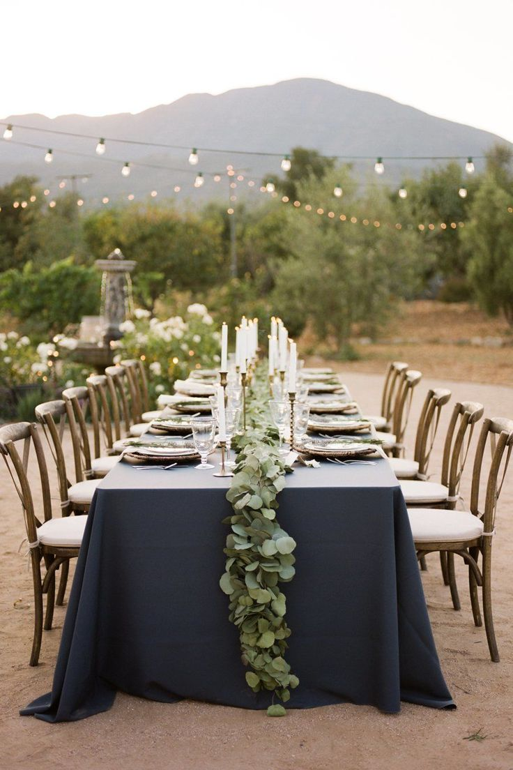 Private Estate navy and greenery wedding table decor: Venue: Private Estate - http://www.vrbo.com/424356Floral Design: Bella Raines Garden Studio - http://www.stylemepretty.com/portfolio/bella-raines-garden-studioGroom's Attire: J.Crew - http://www.jcrew.com/wedding/Wedding_Groom_Groomsmen.jspRead More on SMP: http://www.stylemepretty.com/california-weddings/2017/05/08/intimate-estate-wedding-ojai/