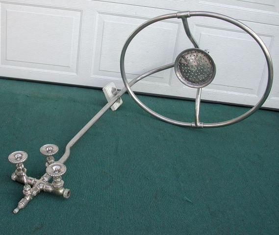Do you drive it or take showers with it?    This Victorian shower head is from an old clawfoot tub. It was recently sold by an antique dealer, price unknown.