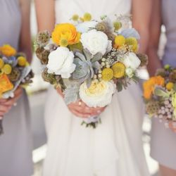Love these gorgeous bouquets from the slight lemon yellow of the rose center to the deep gold of the rose and the greenish grey craspedia.  Throw in some blue and this would be such a pretty option.