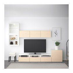 IKEA - BESTÅ, Mueble TV con almacenaje, negro-marrón/Valviken vidrio transparente marrón, riel p/cajón+apetura presión, , Las puertas y cajones llevan un sistema integrado para abrir/cerrar; así no necesitas pomos ni tiradores y se abren con una ligera presión.Los tres grandes cajones permiten organizar los mandos a distancia, las consolas y accesorios del TV.Los armarios de pared te ayudan a aprovechar al máximo el espacio sobre el TV.Es fácil tener los cables del TV y otros ...
