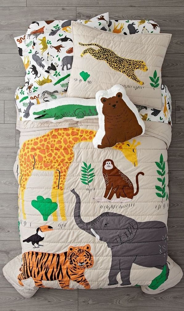 Our Applique Jungle Animal Bedding will give any kids room a wild style upgrade. It features a quilt with appliqued and embroidered jungle animals, plus an organic duvet cover with a multicolor animal print, a sham with a multicolor animal print and another sham with a decorative cheetah. The look is rounded out by a white organic sheet set that includes a flat sheet, fitted sheet and pillowcase with matching wildlife prints.