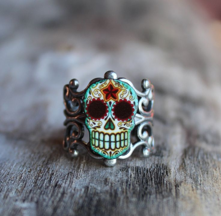 Day of the Dead Filigree Sugar Skull Ring in an Antiqued Silver Finish. $14.95, via Etsy.