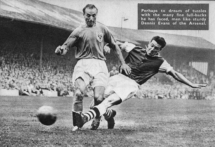 19th April 1957. Blackpool winger Stanley Matthews stopped in his tracks  by Arsenal full back Dennis Evans, at Highbury.