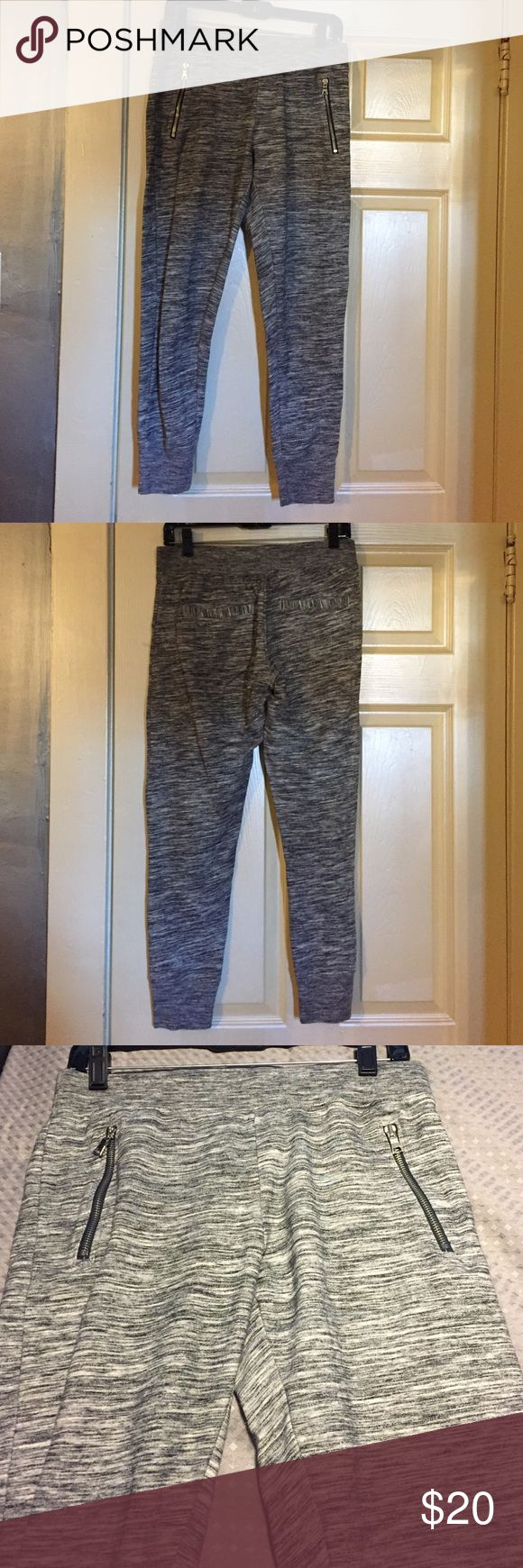 Black and White Joggers Black and white Joggers with zipper front pockets and regular back pockets. Inside tag removed. GAP Pants Track Pants & Joggers