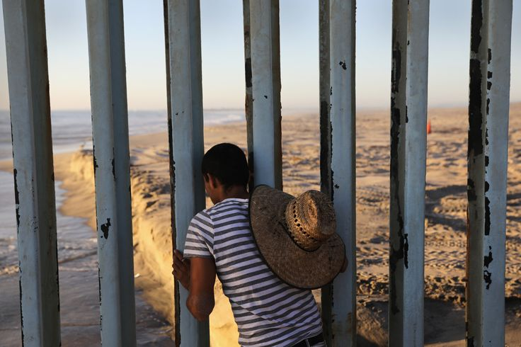 TIJUANA, MEXICO - SEPTEMBER 25: A man looks through the U.S.-Mexico border fence into the United States on September 25, 2016 in Tijuana, Mexico. Friendship Park on the border is one of the few places on the 2,000-mile border where separated families are allowed to meet. (Photo by John Moore/Getty Images) via @AOL_Lifestyle Read more: https://www.aol.com/article/news/2017/01/28/canadas-trudeau-welcomes-refugees-airline-rejects-u-s-bound-p/21702301/?a_dgi=aolshare_pinterest#fullscreen