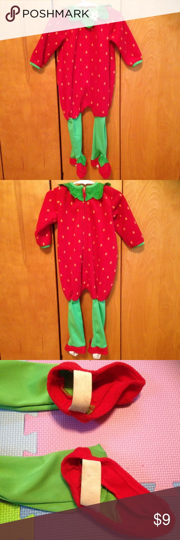 Fleece Strawberry Toddler Costume Your toddler will be adorable and warm as they wear this fleece strawberry Halloween costume. Has a felt collar and thick green tights with elastic straps to go under the shoes. In good condition. Straps have some staining due to wear but it doesn't affect the costume. Size 18 months but is quite long and could fit a 24 mo size. Baby Grand Costumes Halloween
