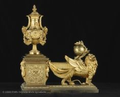 These matching andirons are made up of a base supporting a vase and a winged lion carrying a star-studded globe on its back. Mesdames, as the king's sisters were officially titled, commissioned them from the Darnault brothers for their Grand Salon at the château de Bellevue in 1784, the year they began refurnishing it to suit their tastes.