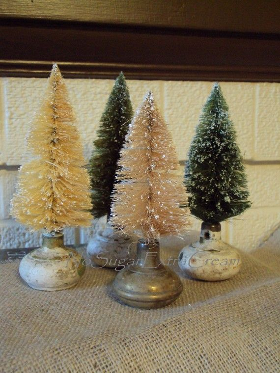 Christmas bottle brush trees in old door knobs....I'd leave these out year round