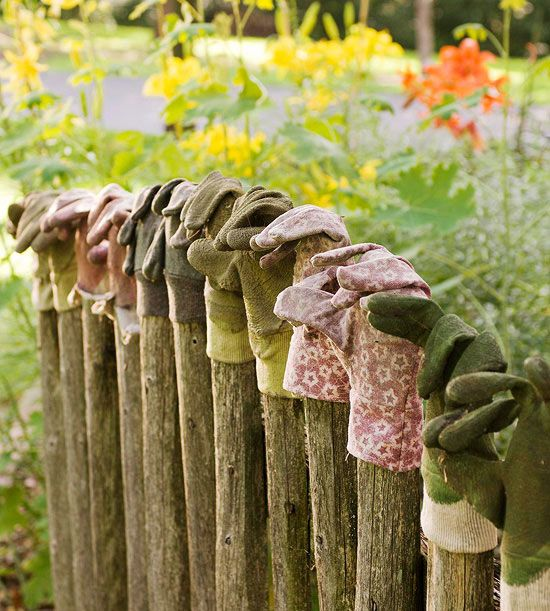 Before you trash those old garden gloves, consider them a display-worthy badge of honor. This wooden fence got a fabric-focused accent with the display of a variety of worn-out gloves.