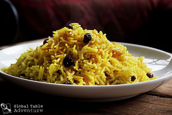 South African Yellow Rice with raisins is made by adding turmeric to the cooking water, along with raisins. In Afrikaans it's called 'Begrafnisrys' which means 'funeral rice'. It refers to the fact that people would usually have to travel a long way for funerals in times when ox-wagons were the most common type of transport, so everything would be done to make the simple ingredients farmers had on hand more 'special'.