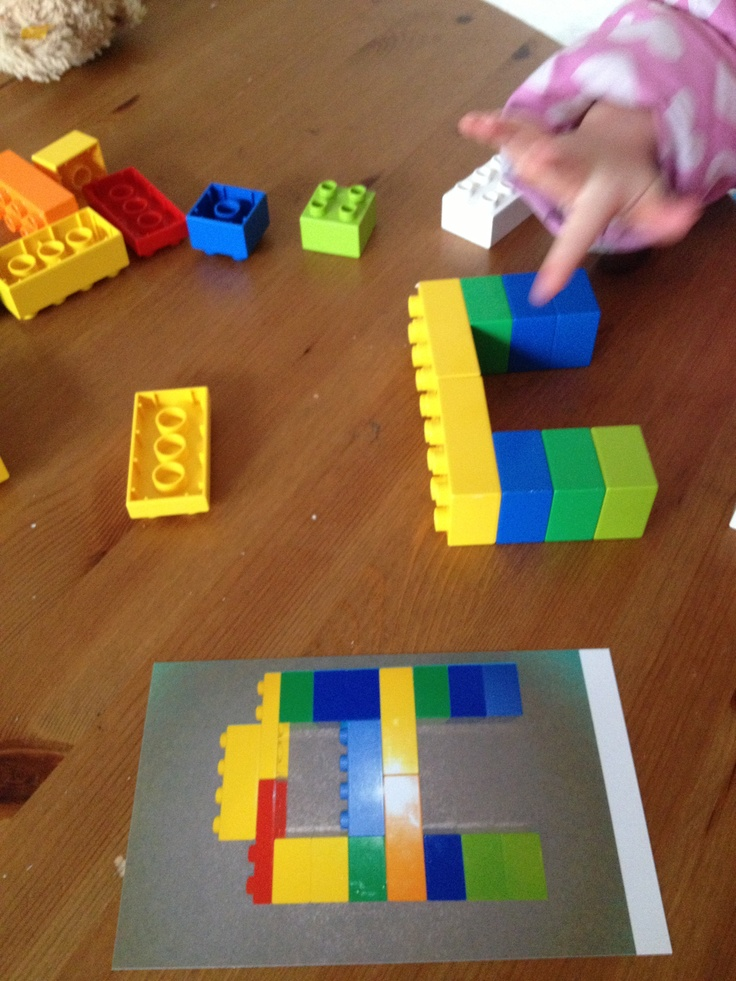 Use duplo for letter recognition http://whattodowiththechildren.com/2013/01/08/letterpattern-recognition-with-duplo/