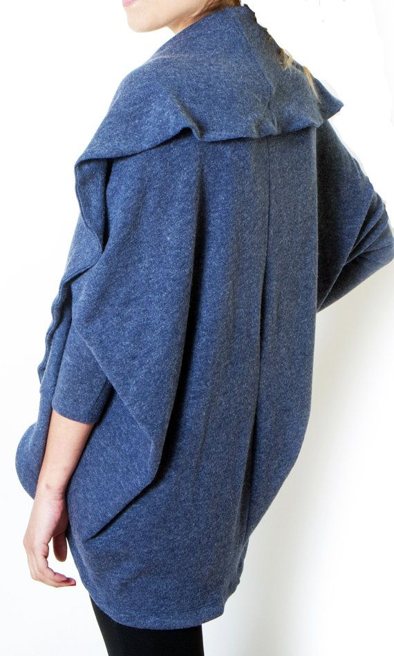 Perfect long blue cardigan for plus size women. The perfect piece for your wardrobe with bat sleeves and an oversize fit. The cardigan last opened can be wear in both side. Its unique, chic stylish. Length waist, above knee length. Ideal for work or dressed up evening look. Available