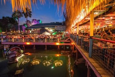 Hula Hut Austin Tx..mix of mexican and polynesian. Good view, food and drinks night/day. On Lake Austin blvd