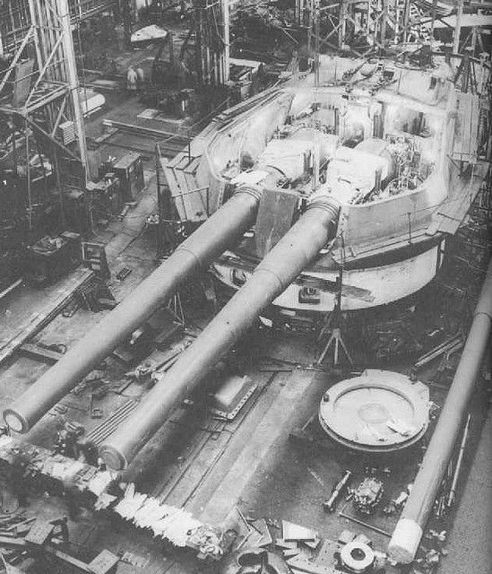 """A fine view of the sheer scale and complexity of the big gun turret for a Battleship. In this case, this appears to be a British 15"""" gun mounting, of the type mounted on R class batlleships, """"Queen Elizabeth"""" class and Renown and Repulse."""