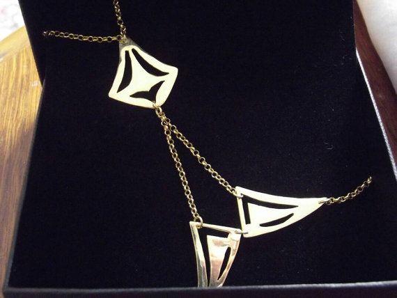 Geometrical slave bracelet by AlphaPiDesigns on Etsy
