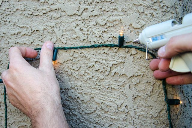 It can be perplexing when it's time to hang the Christmas lights on your home's stucco exterior. You need to safely secure the lights without damaging the finish on your house, and the rough, uneven texture of stucco makes most adhesives ineffective. However, professional lighting designers have found a simple solution for securing lights to this...