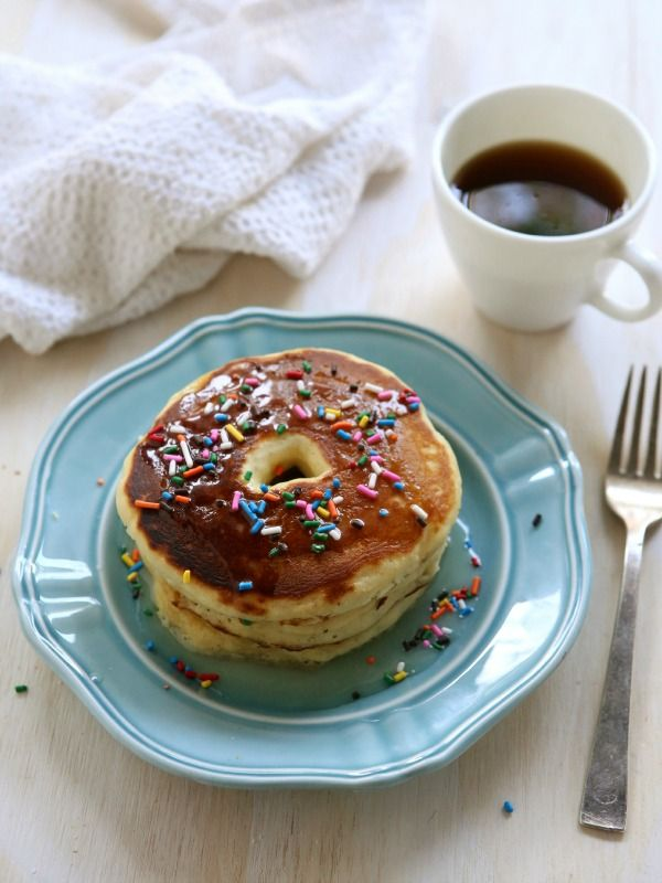 Spoon pancake batter into a ziploc bag and snip the end to make pancake shapes - like these amazing doughnut pancakes - extra easy!