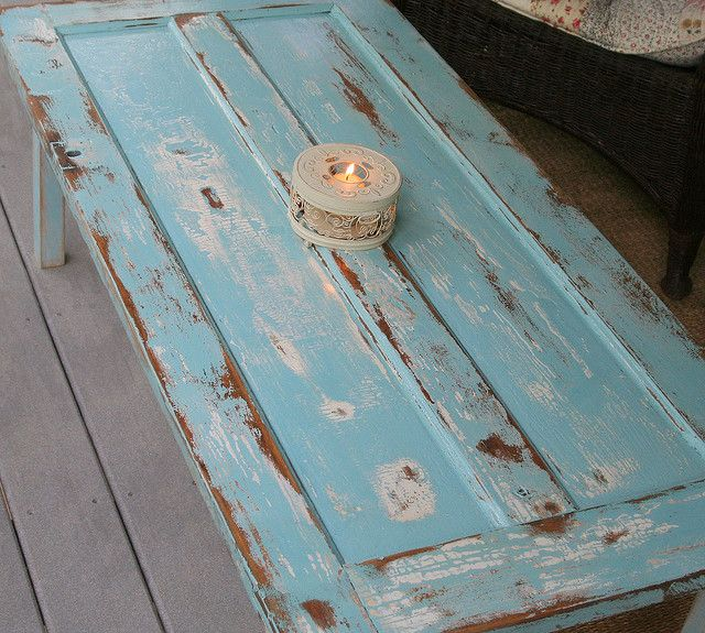 old door made into a table.... I do like the sawhorse table, but these legs would work too...??
