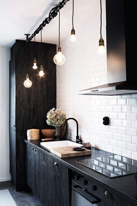 black cabinets, light reflecting tile, minimal, strategic lighting & hardware.
