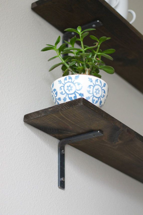 Our L shelf bracket creates a simple, minimalist design for your open shelving projects. INCLUDES COMPLETE MOUNTING KIT: ‌• ONE shelf bracket with pre-drilled holes (in bracket legs and the arm that holds the shelf) ‌• Four matching 1/4 lag bolts (great for hanging heavier shelves) and dry wall screws for lighter loads. ‌• Directions to hang your new wall brackets QUESTIONS? Please see our FAQS below and bracket diagram in last photo. ABOUT OUR STEEL: We use American made steel, sourced…