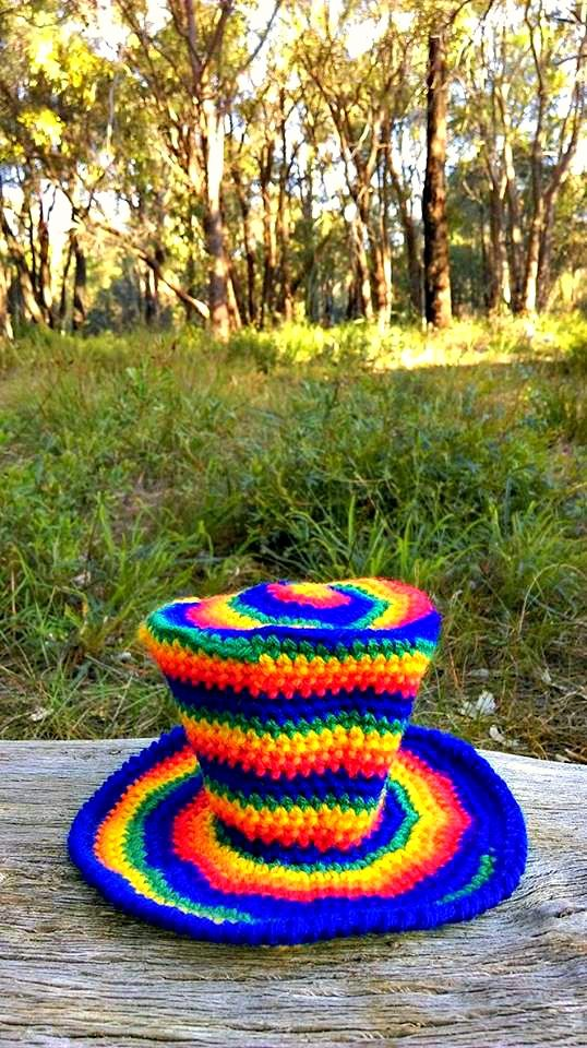 Rainbow Spiral Mini Top Hat.   Project information and pattern notes here;   http://www.ravelry.com/projects/LindaDavie/rainbow-spiral-mini-top-hat