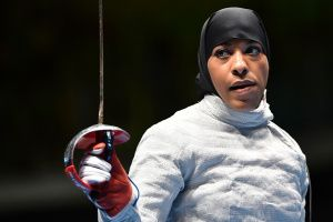 US Ibtihaj Muhammad reacts competing against France's Cecilia Berder in  their womens individual sabre qualifying bout as part of the fencing event of the Rio 2016 Olympic Games, on August 8, 2016, at the Carioca Arena 3, in Rio de Janeiro. / AFP / Fabrice COFFRINI        (Photo credit should read FABRICE COFFRINI/AFP/Getty Images)