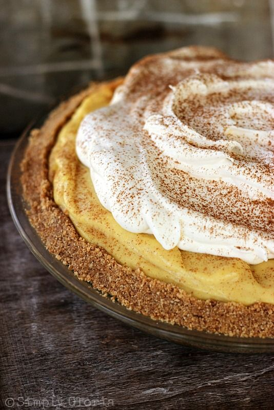 {No Bake} Eggnog Pie Recipe ~ A cinnamon, brown sugar graham cracker crust filled to the edges with a an abundance of a creamy infused eggnog filling.  A layer of whipped cream finishes off the pie.  Then garnished with more cinnamon!