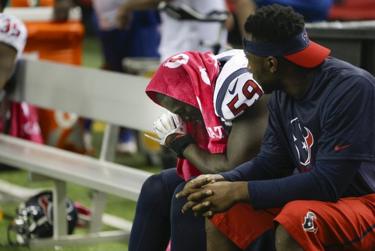 Houston Texans outside linebacker Whitney Mercilus (59) and linebacker Kourtnei Brown sit on the bench during the fourth quarter of an NFL football game against the Atlanta Falcons at the Georgia Dome on Sunday, Oct. 4, 2015, in Atlanta. ( Brett Coomer / Houston Chronicle )
