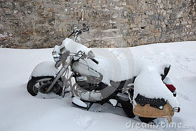 Chopper Motorcycle Covered with Snow and Ice