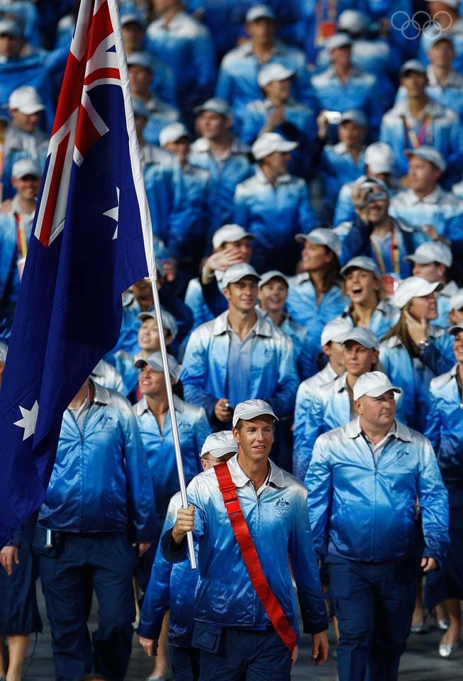 BEIJING - AUGUST 08:  James Tomkins of the Australia Olympic rowing team carries his country's flag to lead out the delegation during the Opening Ceremony for the 2008 Beijing Summer Olympics at the National Stadium on August 8, 2008 in Beijing, China.