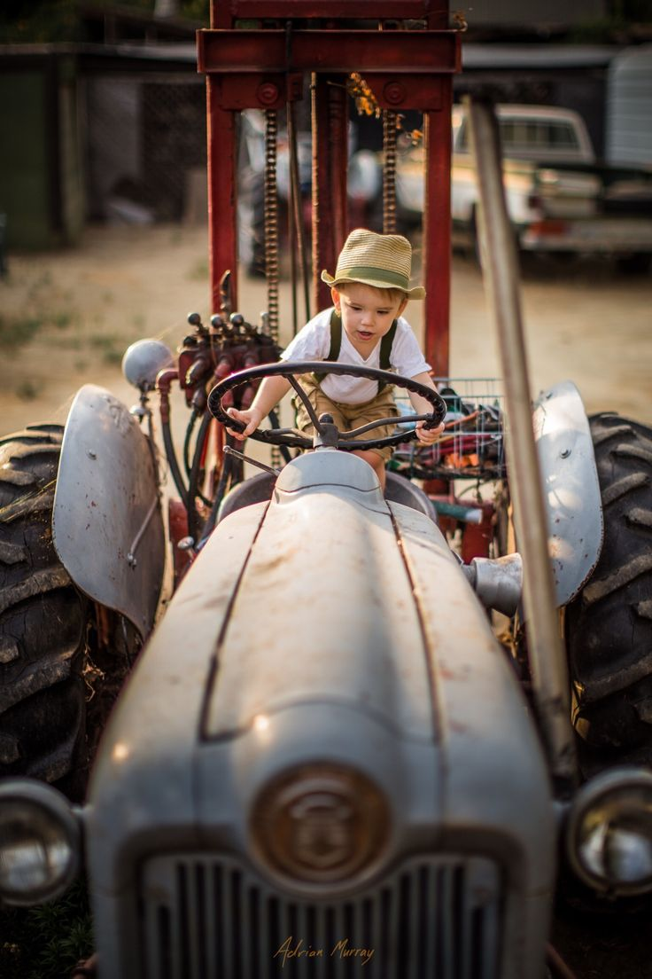 Farm boy - My oldest son on my grandpa's tractor from this past summer. It's getting cold now so I'm feeling nostalgic for warmer weather.