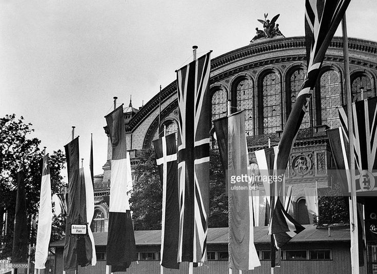Germany Free State Prussia Brandenburg Province Berlin: Olympic Games in Berlin: flags of the participating countries at the Askanischer Platz. In the background the south facade of the Anhalter Bahnhof after the plans of Franz Schwechten - Photographer: Heinz Fremke - Published by: 'B.Z.' Vintage property of ullstein bild