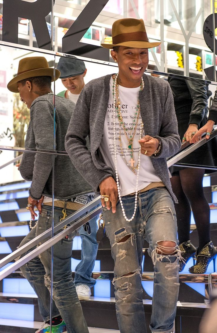 Same man, different hat. Pharrell Williams switches up his style at Uniqlo's I Am Other collection launch party on April 28 in New York