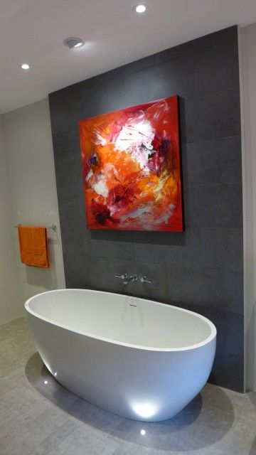 recessed downlighters, a wall washer to highlight the wall art and two floor recessed uplighters to accent the freestanding bath.