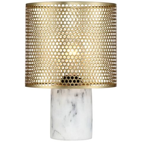 Geometric cutouts line the brass shade of this marble-like accent table lamp, giving it an enchanting output.