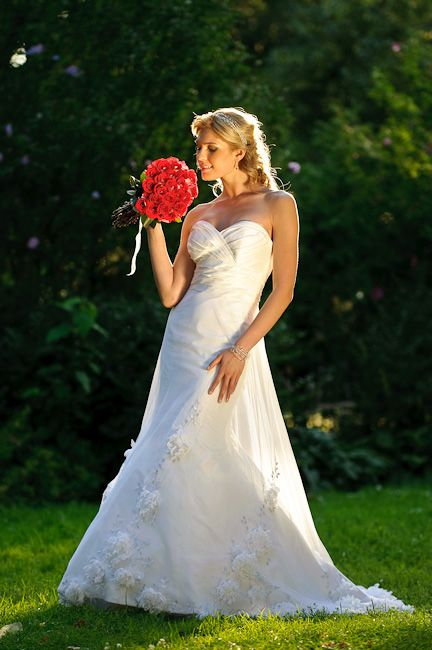 Wedding dress and red flowers