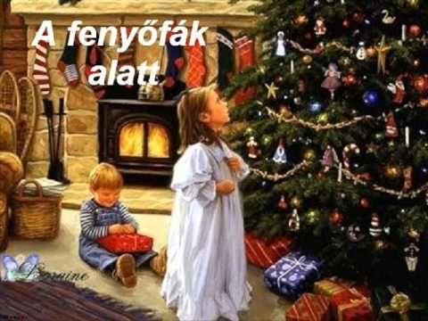 Karácsonyi dal - A fenyőfák alatt