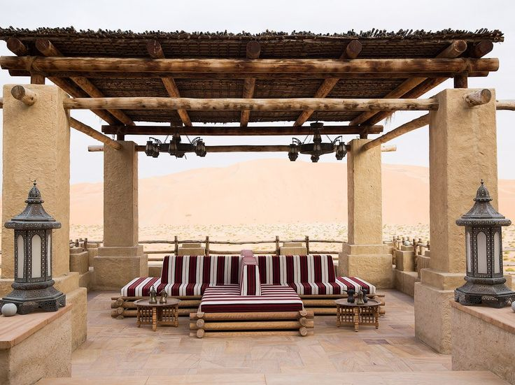 """A two-hour drive south of Abu Dhabi, Anantara's Qasr Al Sarab Resort is a """"true oasis in the desert,"""" says Helou. """"The wonderfully plush rooms have Arabian arches and terraces that look out over the palm-ringed pool toward the dunes."""""""