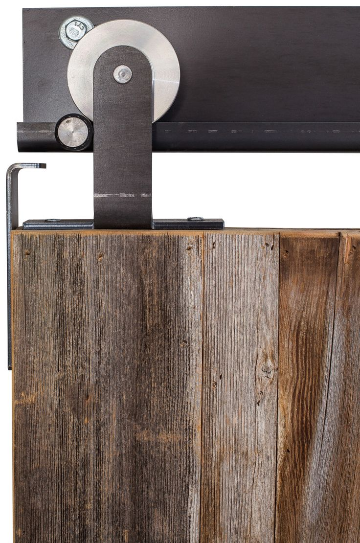 Designed for mounting to the top of the door verses the face of the door, this Modern™ hanger allows for the functionality of rolling barn door hardware without the traditional face mounted installation. Characterized by its rounded top edge, the Modern™ leaves the wheel exposed and visible as it rolls along the track, adding sleek...