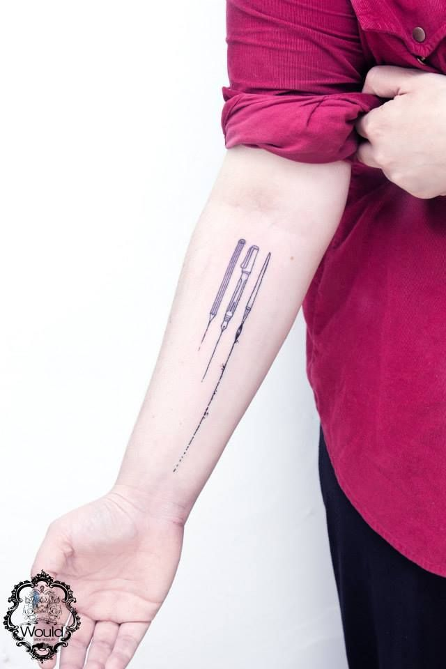 Black Paintbrush And Pencil Tattoo On Forearm