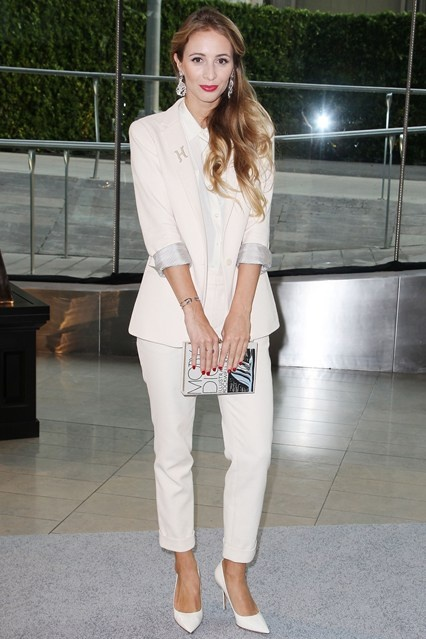 Harley Viera-Newton wore a Steven Alan white suit and carried a clutch by Olympia Le Tan.