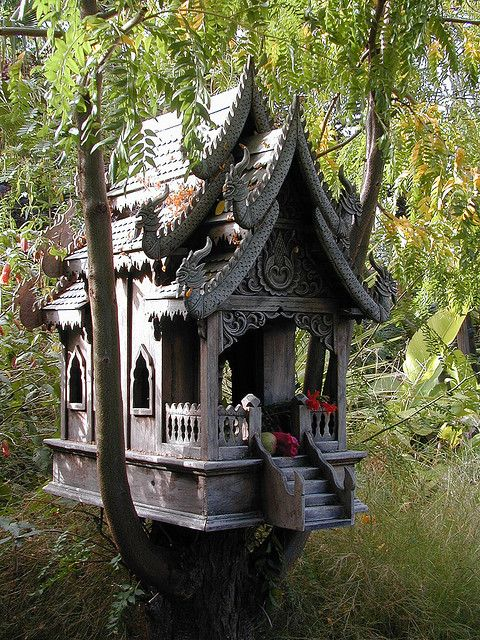 *A spirit house shelters protective spirits and prevents them from interfering with the living. (Thai Buddhist)
