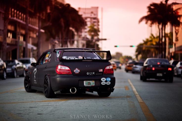 Subaru WRX. Stickerbombed/flat black. Love it.