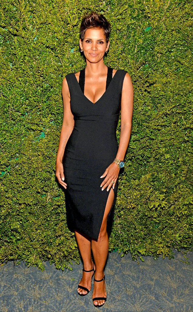 A pregnant Halle Berry is absolutely glowing in a figure-hugging little black dress.